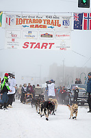 Jeff King and team leave the ceremonial start line at 4th Avenue and D street in downtown Anchorage during the 2013 Iditarod race. Photo by Jim R. Kohl/IditarodPhotos.com