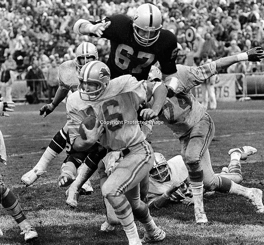 Raiders Pat Toomay about to sack Detroil Lions QB Gary Danielson..(1978 photo/Ron Riesterer)