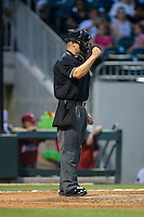 Home plate umpire Chris Segal makes a strike call during the International League game between the Lehigh Valley Iron Pigs and the Charlotte Knights at BB&T BallPark on June 3, 2016 in Charlotte, North Carolina.  The Iron Pigs defeated the Knights 6-4.  (Brian Westerholt/Four Seam Images)