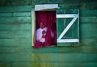 Colorful curtains and walls are common for homes in the Awas Tingni Indian community, a small Misquito community near Pearl Lagoon in Nicaragua, April, 2009. As a result of being geographically and culturally isolated from the rest of Nicaragua, the Caribbean coast of Nicaragua has remained home to some of the largest remaining populations of indigenous Moskito and Garifuna communities.