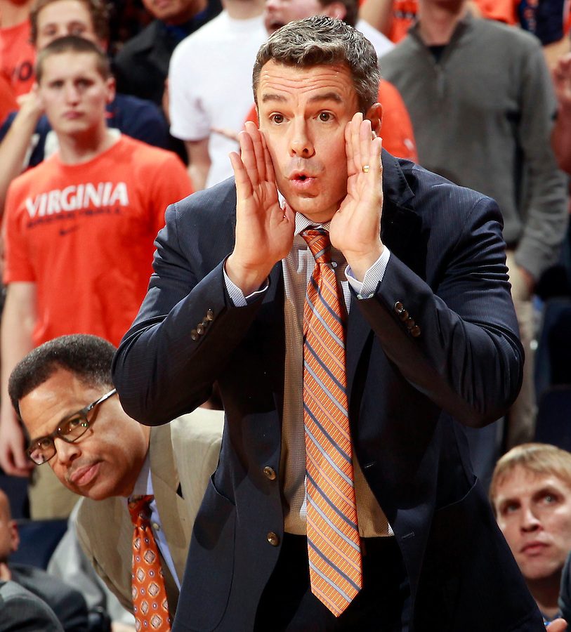 Virginia head coach Tony Bennett calls to his players next to associate head coach Ritchie McKay during an ACC basketball game Jan. 13, 2015 in Charlottesville, VA Virginia won 65-42.