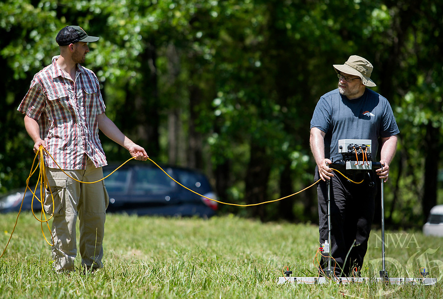 NWA Democrat-Gazette/JASON IVESTER<br /> Allan Wolfrum (cq) (left) with National Parks Service Midwest Archaeological Center and Kris (cq) Lockyear with the University College London Institute of Archaeology use a earth resistance tester Thursday, May 18, 2017, in the area of the Leetown Hamlet at the Pea Ridge National Military Park.