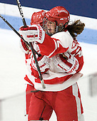 Isabel Menard (BU - 20), Jill Cardella (BU - 22) - The Boston University Terriers defeated the Harvard University Crimson 5-2 on Monday, January 31, 2012, in the opening round of the 2012 Women's Beanpot at Walter Brown Arena in Boston, Massachusetts.