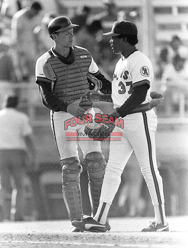 Butch Wynegar and Donnie Moore of the California Angels during a 1988 spring training game in Palm Springs,California.(Larry Goren/Four Seam Images)