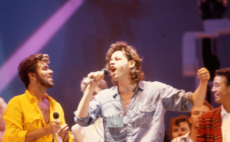 Live Aid 1985 Wembley Stadium, London , England. George Michael, Bob Geldolf, David Bowie, Andrew Ridgeley