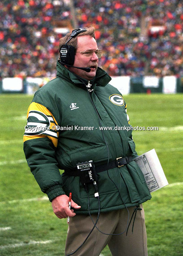 Green Bay Packers Coach Mike Holmgren reacts as a play he called in the December 1, 1996 game against the Chicago Bears results in a touchdown. The Pack won the game, 28-17.