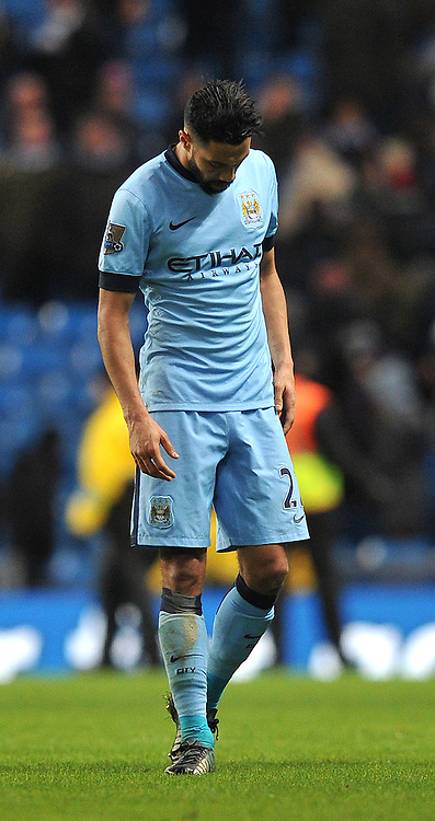 A dejected Manchester City's Ga&euml;l Clichy at the final whistle<br /> <br /> Photographer Dave Howarth/CameraSport<br /> <br /> Football - Barclays Premiership - Manchester City v Arsenal - Sunday 18th January 2015 - Etihad stadium - Manchester<br /> <br /> &copy; CameraSport - 43 Linden Ave. Countesthorpe. Leicester. England. LE8 5PG - Tel: +44 (0) 116 277 4147 - admin@camerasport.com - www.camerasport.com