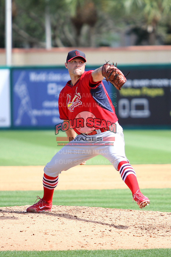 Matt Belisle (37) of the St. Louis Cardinals throws a pitch during a spring training game against the Miami Marlins at the Roger Dean Complex in Jupiter, Florida on March 5, 2015. St. Louis defeated Miami 4-1. (Stacy Jo Grant/Four Seam Images)