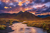 A small tributary of the Yukon River leading to epic sunset light in the foothills of the Tombstone Range, Yukon Territory. <br />