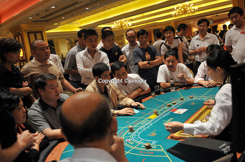 "Gamblers in the Venetian Casino in Macau, 25th October 2008.  Macau is known simply as ""Vegas"" in China. The former Potuguese colony, now a Chinese Special Administrative Region, attracts millions of Chinese gamblers annually and last year earned more gambling dollars than Las Vegas."