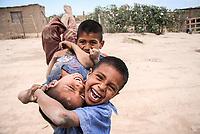 Boy. poor children of popular colony in the town with the most poverty and population in Sonora, Mexico. Miguel Aleman settlement or exit 13. Calle doce. mogrants. bank and black. children, human rights, malnutrition, child malnutrition. (Photo: Luis Gutierrez / NortePhoto.com)<br /> Niño. niños pobres de colonia popular en el poblado con mas pobreza y poblacion fotante en Sonora, Mexico. Poblado Miguel Aleman o salle 13. Calle doce. mograntes.  banco y negro. niñes, derechos hunamos, desnutricion, desnutricion infantil. (Photo: Luis Gutierrez/ NortePhoto.com)<br /> Niños como Mari Cruz Lopez, Jose Angel, Marisol, Angel, daniel, jenifer y otros que ni siquiera saben como se llaman viven al dia en las polvorientas calles en su mayoria descalsos algunos sin educación alguna , otros  con enfermedades de la piel.
