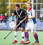 AMSTELVEEN - Camil Papa (Pinoke) met Tom van Hooijdonk (SCHC)  . Hoofdklasse competitie heren. Pinoke-SCHC (0-1) . COPYRIGHT  KOEN SUYK