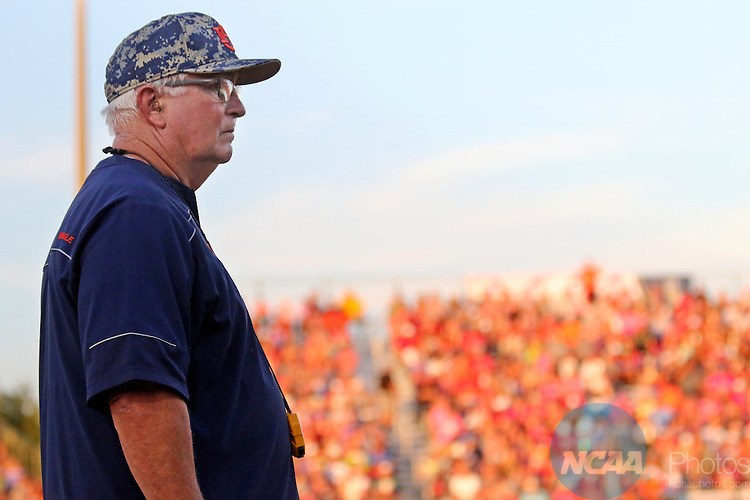 06 JUNE 2016: Clint Myers, Auburn University Head Coach, watches the game against University of Oklahoma during the Division I Women's Softball Championship held at ASA Hall of Fame Stadium in Oklahoma City, OK.  University of Oklahoma defeated Auburn University in Game 1 by the final score of 3-2. Shane Bevel/NCAA Photos