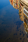 Houses reflected in the River Onyar, Girona, Catalonia, Spain