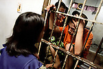A mother talking with her distressed son on visitors day at the prison.  Sometimes the children are in prison for weeks before the parents know where they are.<br />