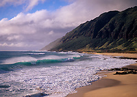 Waves breaking on beach, Yokohama Bay, Oahu, Hawaii, USA.