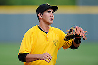 Third baseman Jose Salazar (14) of the Bristol Pirates warms up before a game against the Greeneville Astros on Friday, July 25, 2014, at Pioneer Park in Greeneville, Tennessee. Greeneville won, 9-4. (Tom Priddy/Four Seam Images)