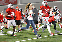 Ohio State University sophomore Hannah Berg gets a chance to work out with members of the OSU football team at the Woody Hayes Athletic Center on April 11, 2015. Students were invited to the facility for the fourth annual Student Appreciation Practice .  (Chris Russell/Dispatch Photo)