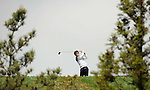 JEJU, SOUTH KOREA - APRIL 23:  Hur In-hoi of Korea tees off on the 18th hole during the fog-delayed Round One of the Ballantine's Championship at Pinx Golf Club on April 23, 2010 in Jeju island, South Korea. Photo by Victor Fraile / The Power of Sport Images