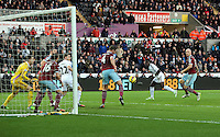 Pictured: A header by Bafetimbi Gomis of Swansea goes wide Saturday 10 January 2015<br />
