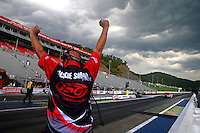 Jun 21, 2015; Bristol, TN, USA; A crew member celebrate the win by NHRA pro mod driver Rickie Smith during the final round of the Thunder Valley Nationals at Bristol Dragway. Mandatory Credit: Mark J. Rebilas-