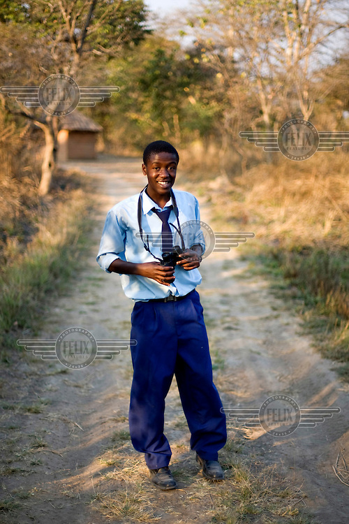 """16 year old Andrew Nyumba from Kafinda basic school in Sereje district, on her first safari in Kasanka National Park. """"The visit has been different from normal life - watching wild animals is more fun than normal life. Monkeys are my favourite animals so watching them makes me feel good."""" Local schools and women's groups are regularly brought into Kasanka, which is unique in the country and unusual in Africa as it is privately managed and owned by a trust. People are able to see animals flourishing in land which was once free reign for poachers. Combined with anti-poaching scouts, the education programme is on the frontline of conservation methods in the park, showing local people wild animals in their natural habitat."""