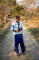 "16 year old Andrew Nyumba from Kafinda basic school in Sereje district, on her first safari in Kasanka National Park. ""The visit has been different from normal life - watching wild animals is more fun than normal life. Monkeys are my favourite animals so watching them makes me feel good."" Local schools and women's groups are regularly brought into Kasanka, which is unique in the country and unusual in Africa as it is privately managed and owned by a trust. People are able to see animals flourishing in land which was once free reign for poachers. Combined with anti-poaching scouts, the education programme is on the frontline of conservation methods in the park, showing local people wild animals in their natural habitat."