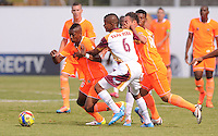ENVIGADO -COLOMBIA-26-07-2014. Yony Gonzalez (Izq) y Jhonatan Alvarez (Der) jugadores de Envigado FC disputan el balón con Wilmar Barrios (C) de Deportes Tolima durante partido por la fecha 2 de la Liga Postobón II 2014 realizado en el Polideportivo Sur de la ciudad de Envigado./ Yony Gonzalez (L) and Jhonatan Alvarez (R) of Envigado FC fight for the ball with Wilmar Barrios (C) of Deportes Tolima during match for the second date of the Postobon League II 2014 at Polideportivo Sur in Envigado city.  Photo: VizzorImage/Luis Ríos/STR