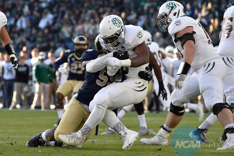 19 DEC 2015:  Octavius Thomas (55) of Shepherd University tackles Phil Jackson II (28) of Northwest Missouri State University during the Division II Men's Football Championship held at Sporting Park in Kansas City, KS. Northwest Missouri State defeated Shepherd 34-7 for the national title.  Justin Tafoya/NCAA Photos