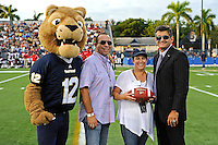 24 September 2011:  FIU Athletic Director Pete Garcia and FIU's mascot, Roary, present the game ball at the end of the first quarter as the University of Louisiana-Lafayette Ragin Cajuns defeated the FIU Golden Panthers, 36-31, at FIU Stadium in Miami, Florida.