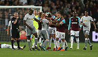 West Ham United's Mark Noble reacts angrily to Manchester United's Paul Pogba after a challenge by Pogba on Noble<br /> <br /> Photographer Rob Newell/CameraSport<br /> <br /> The Premier League - West Ham United v Manchester United - Thursday 10th May 2018 - London Stadium - London<br /> <br /> World Copyright &copy; 2018 CameraSport. All rights reserved. 43 Linden Ave. Countesthorpe. Leicester. England. LE8 5PG - Tel: +44 (0) 116 277 4147 - admin@camerasport.com - www.camerasport.com