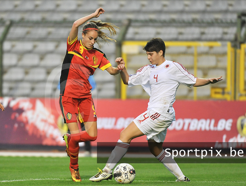 20130921 - BRUSSELS , BELGIUM : Belgian Tessa Wullaert (9)  pictured  with Albanian Rrahmani Albina (4) during the female soccer match between Belgium and Albania , on the first matchday in group 5 of the UEFA qualifying round to the FIFA Women World Cup in Canada 2015 at the Koning Boudewijn Stadion , Brussels . Saturday 21th September 2013. PHOTO DAVID CATRY