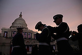 Members of the military prepare at sun rise before the presidential inauguration on the West Front of the U.S. Capitol January 21, 2013 in Washington, DC.   Barack Obama was re-elected for a second term as President of the United States.       .Credit: Win McNamee / Pool via CNP