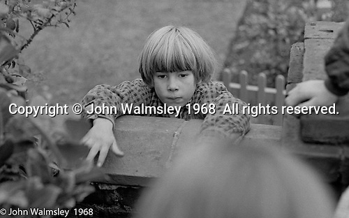Playing on the school's outside wall, Summerhill school, Leiston, Suffolk, UK. 1968.