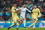 Isco Alarcon (C) of Real Madrid is followed by Rodrigo Hernandez Cascante, Rodri (L), of Villarreal CF during the La Liga 2017-18 match between Real Madrid and Villarreal CF at Santiago Bernabeu Stadium on January 13 2018 in Madrid, Spain. Photo by Diego Gonzalez / Power Sport Images