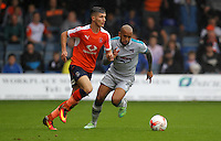 Dan Potts of Luton Town and Ashley Chambers of Grimsby Town during the Sky Bet League 2 match between Luton Town and Grimsby Town at Kenilworth Road, Luton, England on 10 September 2016. Photo by Harry Hubbard / PRiME Media Images.