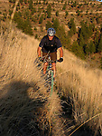A senior mountain biker negotiates a single track trail on the Echo Ridge Trail system