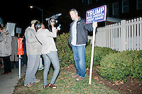 Boston Herald reporters interview Trump supporter Robert Wright of Portsmouth, New Hampshire, near where supporters of Donald Trump gathered near the Sheraton Portsmouth Harborside Hotel in Portsmouth, New Hampshire, USA. At the hotel later that evening, Republican presidential candidate and real estate mogul Donald Trump received an endorsement from the New England Police Benevolent Association executive council. A small group of perhaps 20 Trump supporters stood outside the hotel and there was a larger group of anti-Trump protesters, mostly across the street. One of the protest organizers estimated that there were around 230 protesters gathered.Many protesters expressed disagreement with Trump's recent statements that he would ban all Muslims from entering the country. Trump brought up the recent shooting in San Berdardino, Calif., at the meeting.