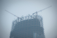 Daytime landscape view of the Tianjin World Financial Center under construction in the Heping District in Tiānjīn.  © LAN