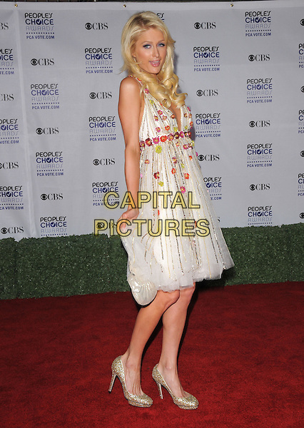 PARIS HILTON.Arrivals at the 35th Annual People's Choice Awards held at The Shrine Auditorium in Los Angeles, California, USA..January 7th, 2009.full length white dress gold sparkly shoes sheer sequins sequined floral print bag purse cream.CAP/DVS.©Debbie VanStory/Capital Pictures.