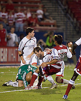 FC Dallas forward Carlos Ruiz (20) attempts a shot as New England Revolution goalkeeper Matt Reis (1) makes a save backed up by midfielder Steve Ralston (14) and defender Jay Heaps (6).  New England Revolution defeated FC Dallas 3-2 to capture the 2007 Lamar Hunt U.S. Open Cup at Pizza Hut Park in Frisco, TX on October 3, 2007.