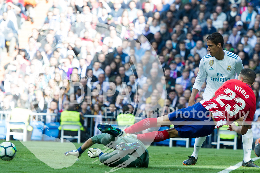Atletico Madrid&rsquo;s Spanish midfielder Vitolo; Real Madrid's Costa Rican goalkeeper Keylor Navas<br /> Spanish league football match Real Madrid vs Atletico de Madrid at the Santiago Bernabeu stadium in Madrid on April 8, 2018.