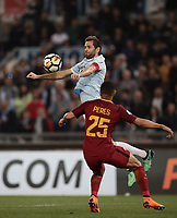 Calcio, Serie A: S.S. Lazio - A.S. Roma, stadio Olimpico, Roma, 15 aprile 2018. <br /> Lazio's captain Senad Lulic (top) in action With Roma's Bruno Peres (bottom) during the Italian Serie A football match between S.S. Lazio and A.S. Roma at Rome's Olympic stadium, Rome on April 15, 2018.<br /> UPDATE IMAGES PRESS/Isabella Bonotto