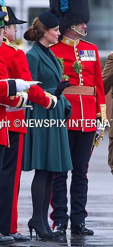 """CATHERINE, DUCHESS OF CAMBRIDGE_AND PRINCE WILLIAM.attend the St. Patrick's Day Parade at Mons Barracks, Aldershot_17/03/2013.Prince William attended as Colonel of the Regiment while Kate presented the traditional sprgs of shamrock to the Officers and Guardsmen.Mandatory credit photo:©Dias/NEWSPIX INTERNATIONAL..**ALL FEES PAYABLE TO: """"NEWSPIX INTERNATIONAL""""**..PHOTO CREDIT MANDATORY!!: NEWSPIX INTERNATIONAL(Failure to credit will incur a surcharge of 100% of reproduction fees)..IMMEDIATE CONFIRMATION OF USAGE REQUIRED:.Newspix International, 31 Chinnery Hill, Bishop's Stortford, ENGLAND CM23 3PS.Tel:+441279 324672  ; Fax: +441279656877.Mobile:  0777568 1153.e-mail: info@newspixinternational.co.uk"""