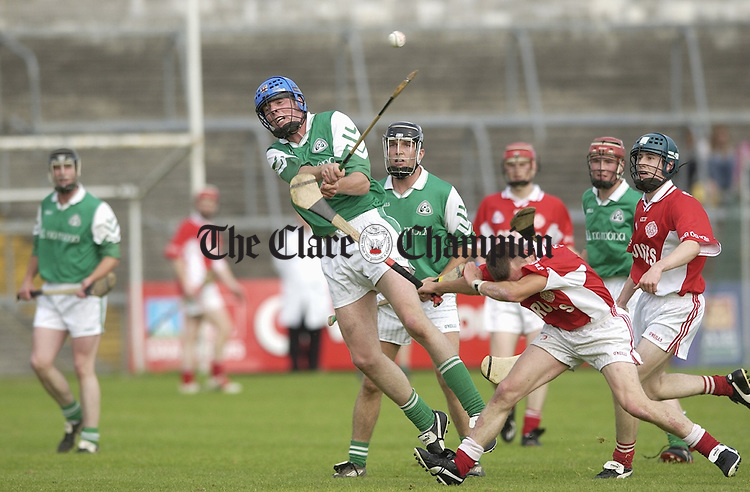 Cathal Lafferty of Kilnamona gets in his puc during the game against Eire Og in Ennis. Photograph by John Kelly.