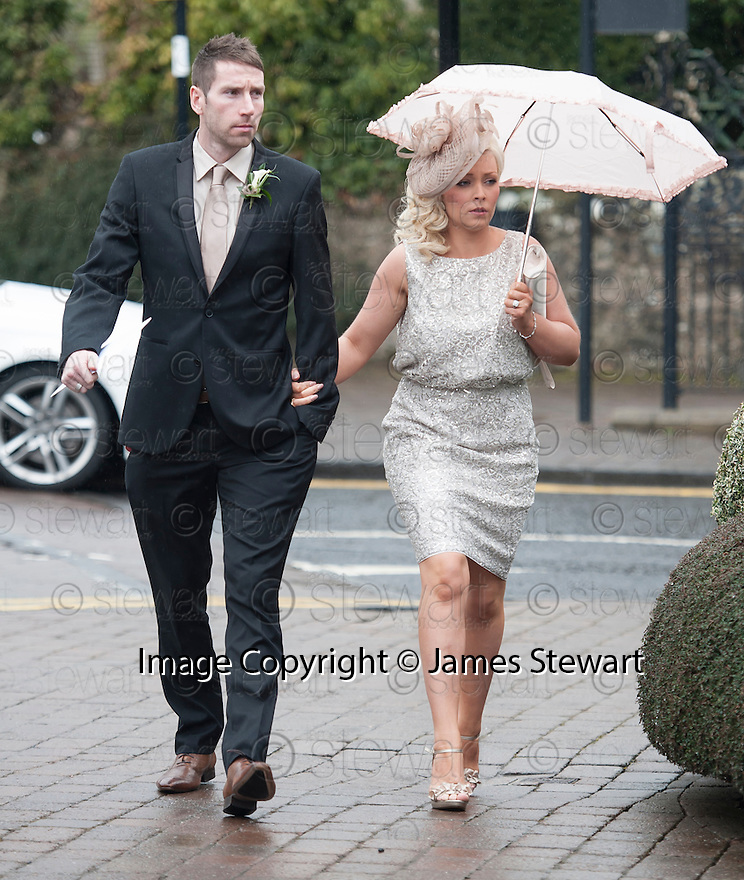 Blackpool and Scotland player Kirk Broadfoot and his wife/partner arrive for the wedding of former teammate Steven Naismith and Moya Jane Farrell at the Brig O'Doon House Hotel, Alloway.