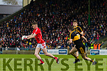 Ronan Buckley, East Kerry in action against Brian Looney, Dr Crokes  during the Kerry County Senior Club Football Championship Final match between East Kerry and Dr. Crokes at Austin Stack Park in Tralee, Kerry.