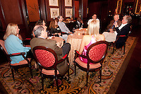 Keith Bellows, Editor and Vice President of National Geographic Traveler, talks travel with guests during an intimate cocktail party held at the Ritz Carlton Coconut Grove, Miami, Florida, USA, March 10, 2010. Photo by Debi Pittman Wilkey