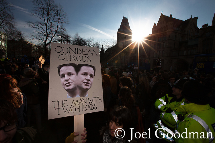© Joel Goodman - 07973 332324 . 24/11/2010 . Manchester , UK . A placard featuring the face of Nick Clegg . Students and their supporters march and demonstrate through Manchester City Centre against government cuts to student support and rising education fees , specifically against an election pledge made by the Liberal Democrats prior to forming the coalition government . Photo credit : Joel Goodman