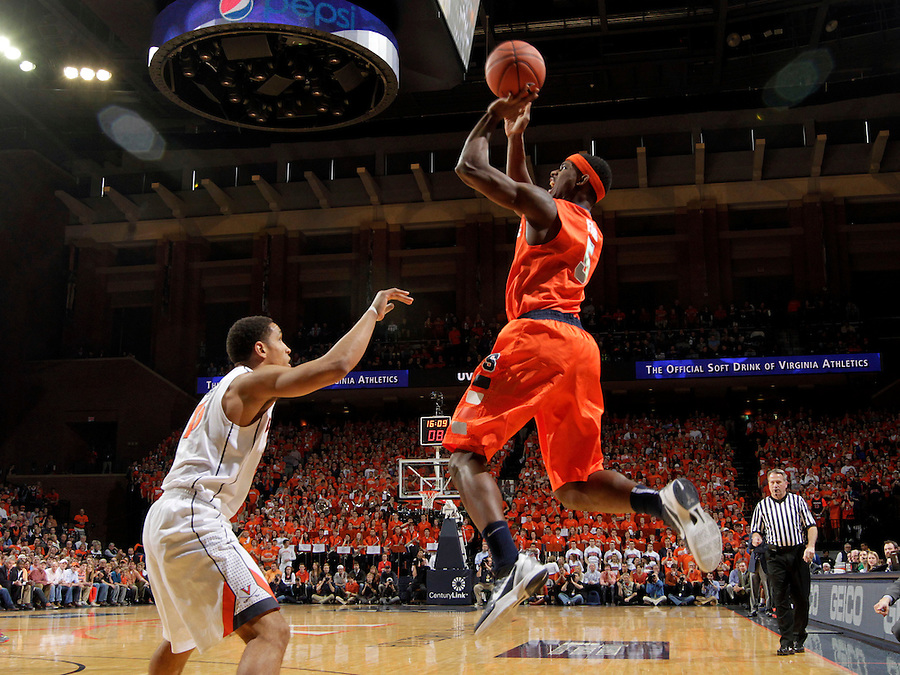 Syracuse forward C.J. Fair (5)shoots over Virginia guard Malcolm Brogdon (15) during an NCAA basketball game Saturday March 1, 2014 in Charlottesville, VA. Virginia defeated Syracuse 75-56.